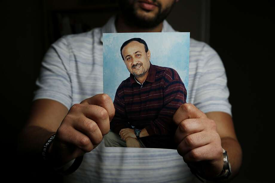Arab Barghouti holds a photo of his father, Marwan Barghouti, in Belmont. Photo: Santiago Mejia, The Chronicle