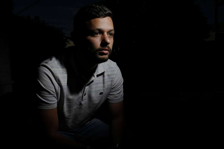 Arab Barghouti sits for a portrait outside his home in Belmont. Photo: Santiago Mejia, The Chronicle