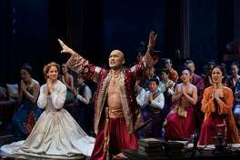 """""""The King and I"""" stars Laura Michelle Kelly, as Anna, left, and Jose Llana, as the king, center, May 30 to June 4 at the Bushnell in Hartford."""
