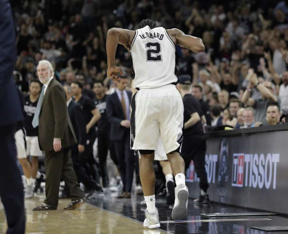 San Antonio Spurs forward Kawhi Leonard limps off the court during the second half of Game 5 in the second-round playoff series against the Houston Rockets. The Spurs won the series, anyway, and a reader says Leonard deserved more respect than he got from a certain newspaper. Photo: Eric Gay /Associated Press / Stratford Booster Club