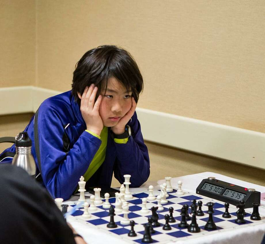 "Whitby fifth grader Maxmillian Lu recently won the ""Triple Crown"" of scholatic chess, claiming victory in classical, Bughouse and Blitz chess at a U.S. Federation of Chess Tournament in Nashville Tennesee in May. Photo: Tony Cortizas Jr. / © 2017 A. P. Cortizas Jr. All rights reserved."