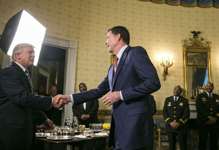 FILE Ñ FBI Director James Comey crosses the room to shake hands after being recognized by President Donald Trump at a gathering of law enforcement officials at the White House in Washington, Jan. 22, 2017. Comey related to a friend that he had been hoping to avoid any interaction at all with Trump at the event. Photo: Al Drago/The New York Times