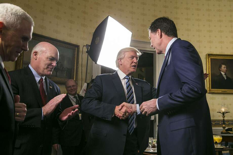 FILE -- President Donald Trump and FBI Director James Comey shake hands during a reception at the White House in Washington, Jan. 22, 2017. Comey believes that a one-on-one dinner with Trump seven days after the inauguration, in which the president asked if Comey would pledge loyalty to him, was a harbinger of his firing, according to two people who have heard ComeyÕs account of the conversation. The White House disputes this account. (Al Drago/The New York Times) Photo: AL DRAGO, NYT