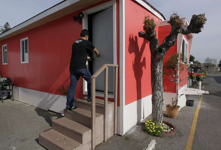 Saul Bracamontes enters his mobile home at the Buena Vista trailer park in Palo Alto on March 14, 2013. Photo: Paul Chinn, The Chronicle