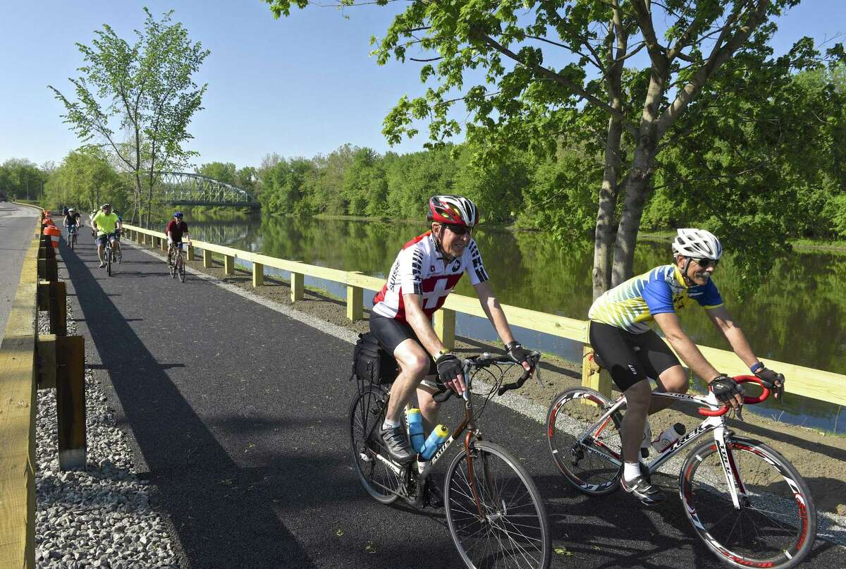 Terry Burke, left, of Cornwall, and Mike Bardelli, of New Milford, ride on the Young's Field Riverwalk during New Milfo rd's second annual Bike to Work event on Friday.