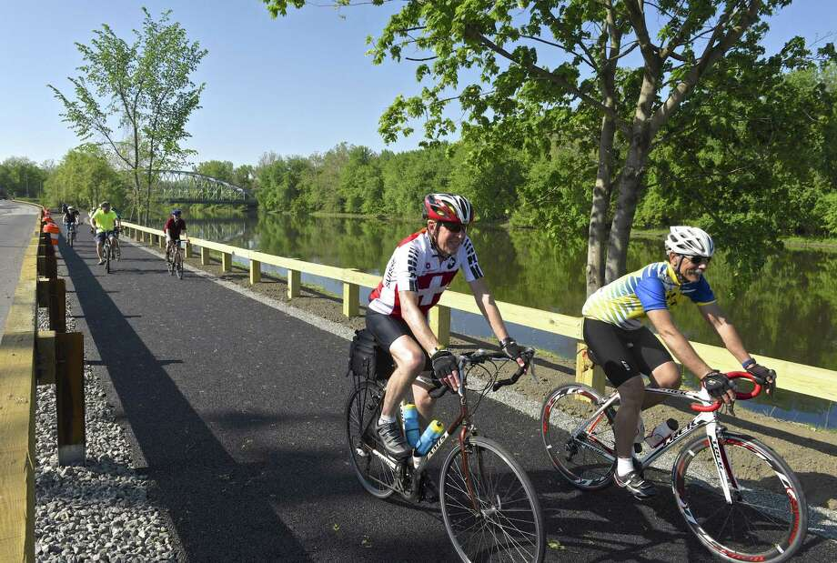 Terry Burke, left, of Cornwall, and Mike Bardelli, of New Milford, ride on the Young's Field Riverwalk during New Milford's second annual Bike to Work event,  Friday, May 19, 2017, in New Milford, Conn. Photo: H John Voorhees III / Hearst Connecticut Media / The News-Times