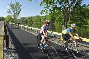 Terry Burke, left, of Cornwall, and Mike Bardelli, of New Milford, ride on the Young's Field Riverwalk during New Milford's second annual Bike to Work event,  Friday, May 19, 2017, in New Milford, Conn.