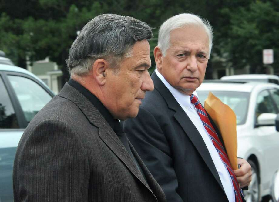 The FBI has a new investigation of Halfmoon developer Bruce Tanski, left, shown with his attorney William Dreyer, after he was arraigned on an eight-count indictment in 2014 accusing him of election law violations. (Lori Van Buren / Times Union) Photo: Lori Van Buren / 00028289A