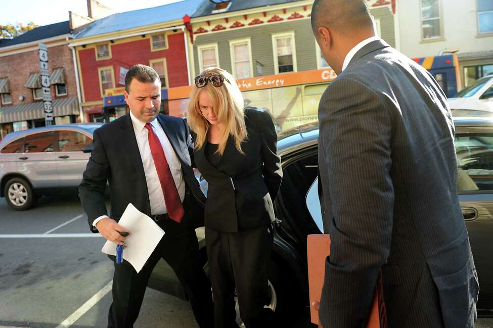 Former Halfmoon Supervisor Melinda A. Wormuth, center, arrives for her arraignment on corruption charges in 2013 at Waterford Town Court. (Cindy Schultz / Times Union)