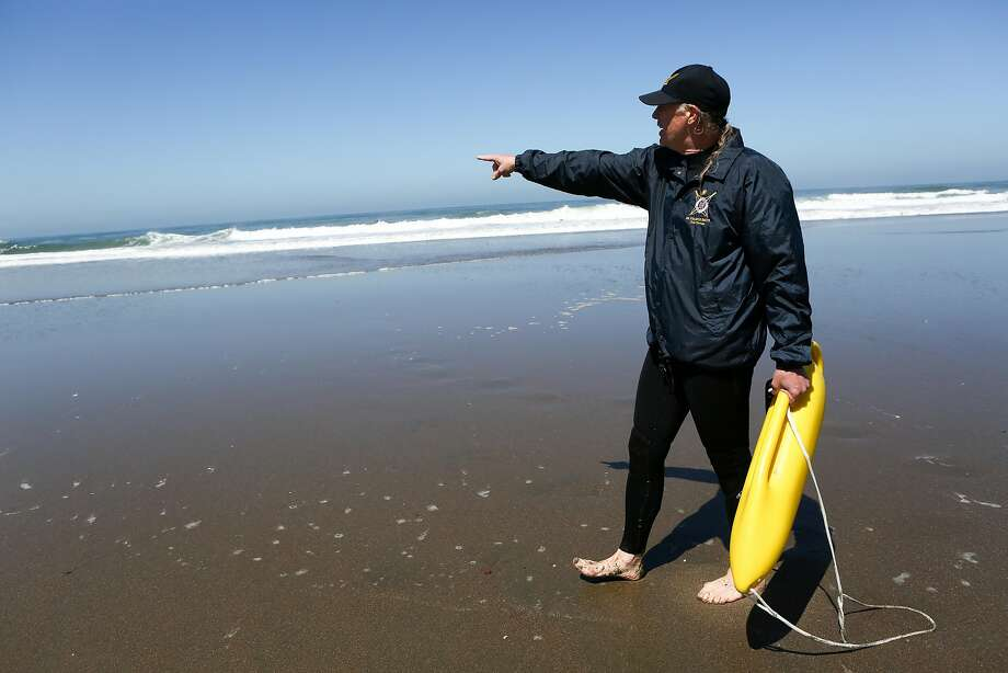 Coastal oceanographer Francis Smith points out a rip current at Ocean Beach. Photo: Amy Osborne, Special To The Chronicle