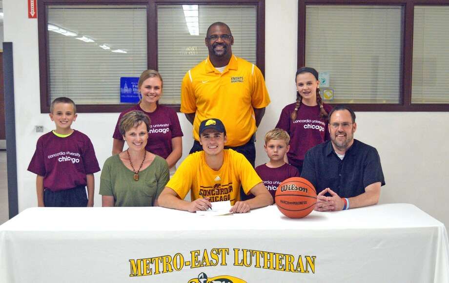 Metro-East Lutheran senior J.J. Schwarz will play basketball at Concordia University Chicago. In the front row, from left to right, are mother Beth Schwarz, J.J. Schwarz and father Jeff Schwarz. In the back row, from left to right, are brother Jack Schwarz, sister Emily Schwarz, MELHS coach Anthony Smith, brother Joey Schwarz and sister Katie Schwarz.