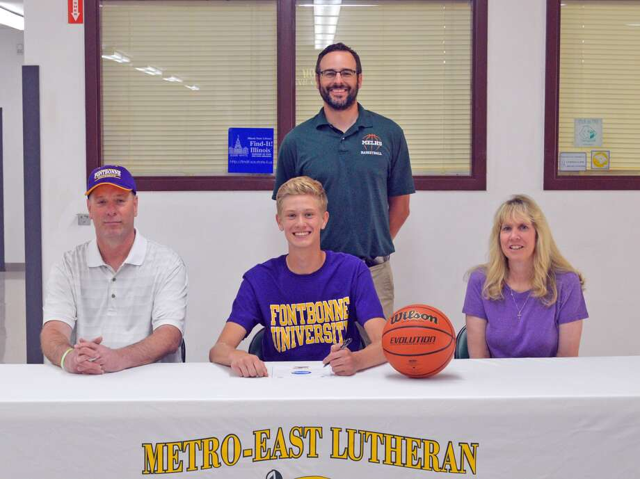 Metro-East Lutheran senior Noah Coddington will play basketball at Fontbonne University. In the front row, from left to right, are father Dan Coddington, Noah Coddington and mother Kathy Coddington. Standing in the back is MELHS assistant coach Joel Rempfer. MELHS head coach Anthony Smith is not pictured.