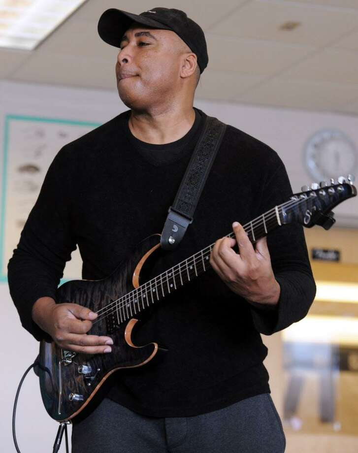 Musician and former professional baseball player, Bernie Williams worked with students at Tisdale School in Bridgeport, Conn. on Monday, March 7, 2016.  Williams mentors the students as part of the national Turnaround Arts program that empowers high-need schools with arts resources, training and arts integration into other subject areas. Photo: Cathy Zuraw Cathy Zuraw / Hearst Connecticut Media / Connecticut Post