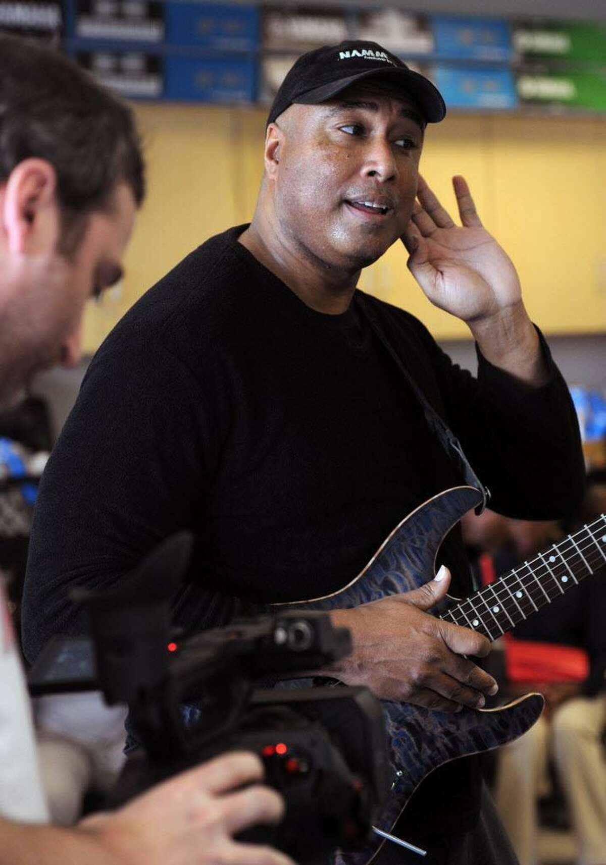Musician and former professional baseball player, Bernie Williams worked with students at Tisdale School in Bridgeport, Conn. on Monday, March 7, 2016. Williams mentors the students as part of the national Turnaround Arts program that empowers high-need schools with arts resources, training and arts integration into other subject areas.