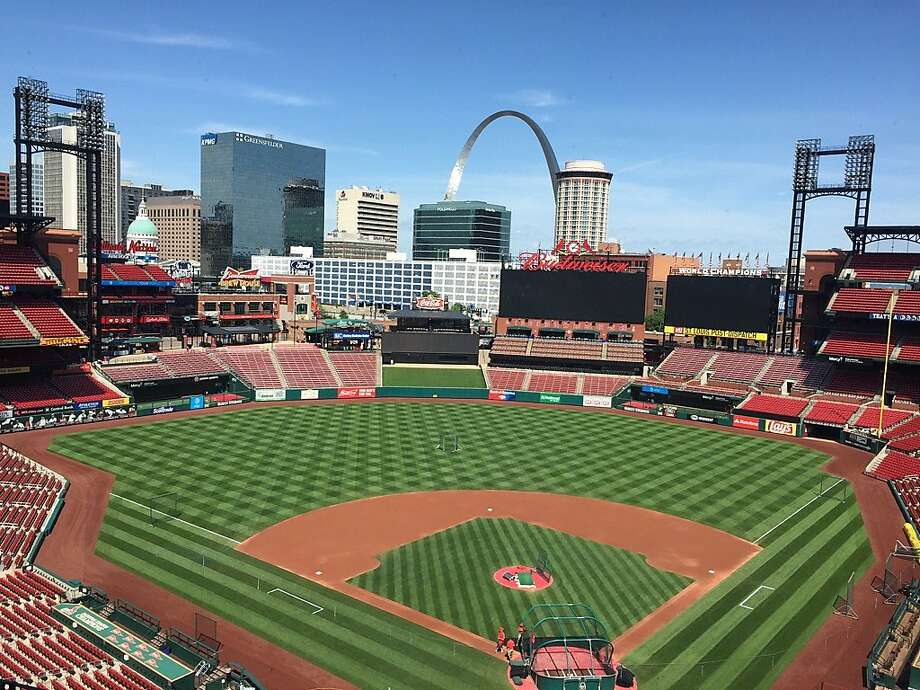 Busch Stadium in St. Louis is resplendent in the sunshine four hours before Friday night's game. In the background is that arch thingy. Photo: Henry Schulman, San Francisco Chronicle