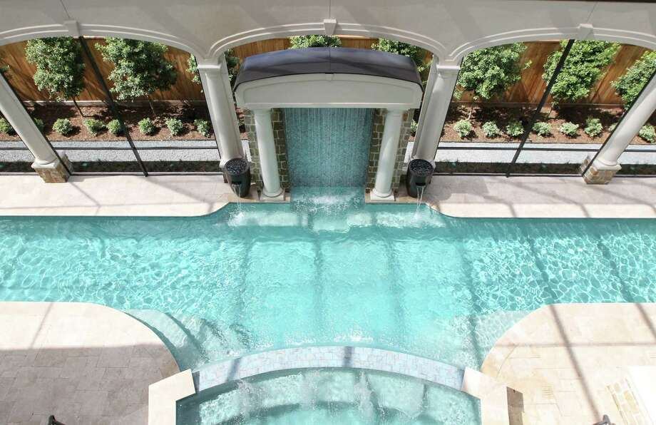 Michael and Stephanie Land's home includes a covered lap pool and a 20-person hot tub. Other features are a golf simulator, 1,100-bottle wine room, party room with karaoke stage and a catering kitchen. Photo: Steve Gonzales, Staff / © 2017 Houston Chronicle