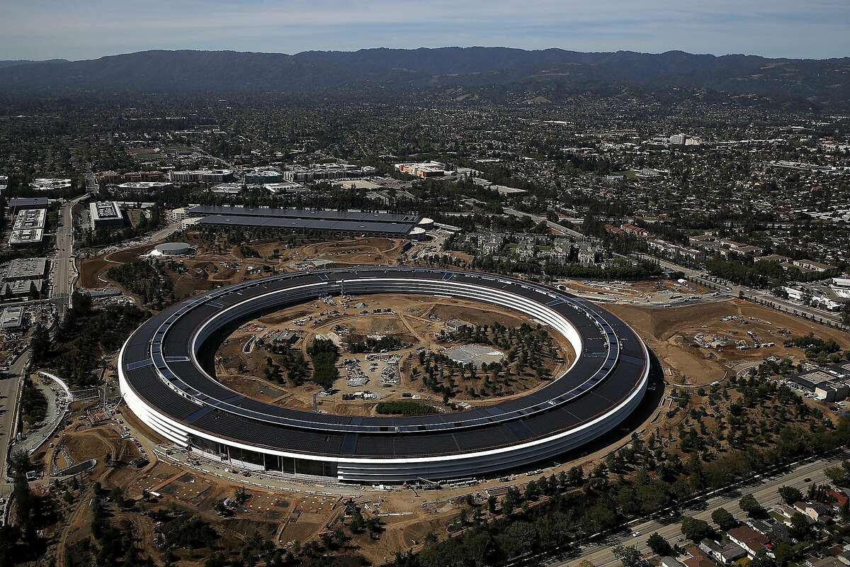 """CUPERTINO, CA - APRIL 28: An aerial view of the new Apple headquarters on April 28, 2017 in Cupertino, California. Apple's new 175-acre 'spaceship' campus dubbed """"Apple Park"""" is nearing completion and is set to begin moving in Apple employees. The new headquarters, designed by Lord Norman Foster and costing roughly $5 billion, will house 13,000 employees in over 2.8 million square feet of office space and will have nearly 80 acres of parking to accommodate 11,000 cars. (Photo by Justin Sullivan/Getty Images)"""