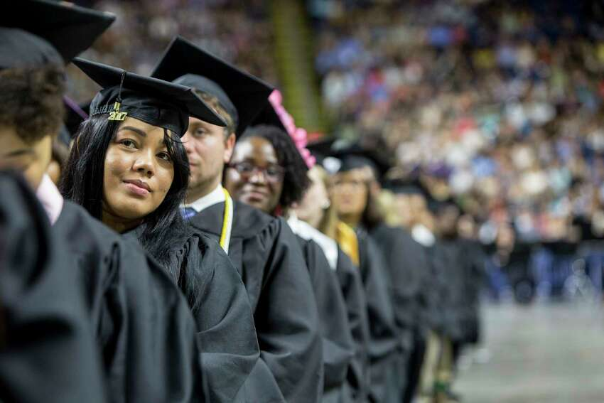 Albalis Yaniret Perozo of West Haven listens to Derreck Kayongo, CEO of the Center for Civil and Human Rights, who delivered the commencement address for the Southern Connecticut State University's class of 2017. The event was held at the Webster Bank Arena in Bridgeport, Conn. on Friday May 19, 2017.