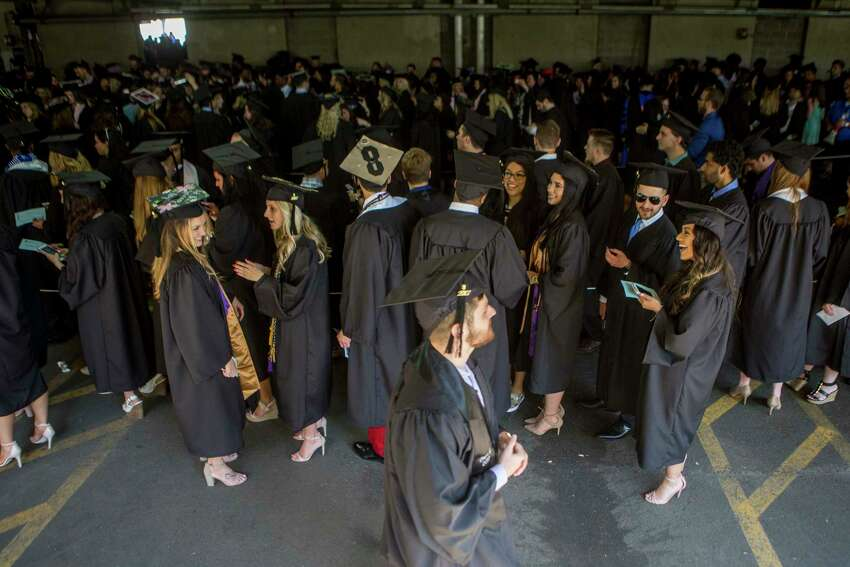 Vincent Baumann of Milford passes by the Business School Graduates lined up before the graduation ceremony for Southern Connecticut State University's class of 2017 took place at the Webster Bank Arena in Bridgeport, Conn. on Friday May 19, 2017.