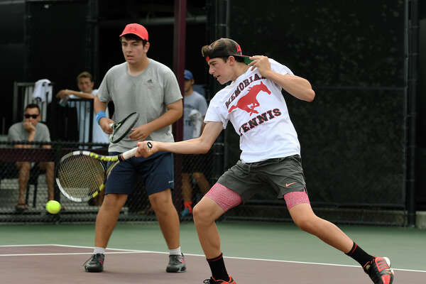 Memorial's Andrew Esses, right, with his doubles partner Artur Zigman, uses his forehand to return a shot against MHS teammates Benjamin Westwick and Anthony Huynh during their Class 6A Boys Doubles final at the UIL State Tennis Championships at Texas A&M University in College Station on Friday, May 19, 2017. (Photo by Jerry Baker/Freelance)