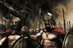 "** FILE ** In this handout photo provided by Warner Bros. Pictures, actors Vincent Regan, left,and Gerard Butler are shown in a still from the action drama 300."" The tale of the Spartan battle of Thermopylae as seen through the unique eyes of graphic novelist Frank Miller captured the top spot at the box office over the weekend, commanding a take of nearly $71 million to become the year's first blockbuster. (AP Photo/Warner Bros. Pictures, file)"