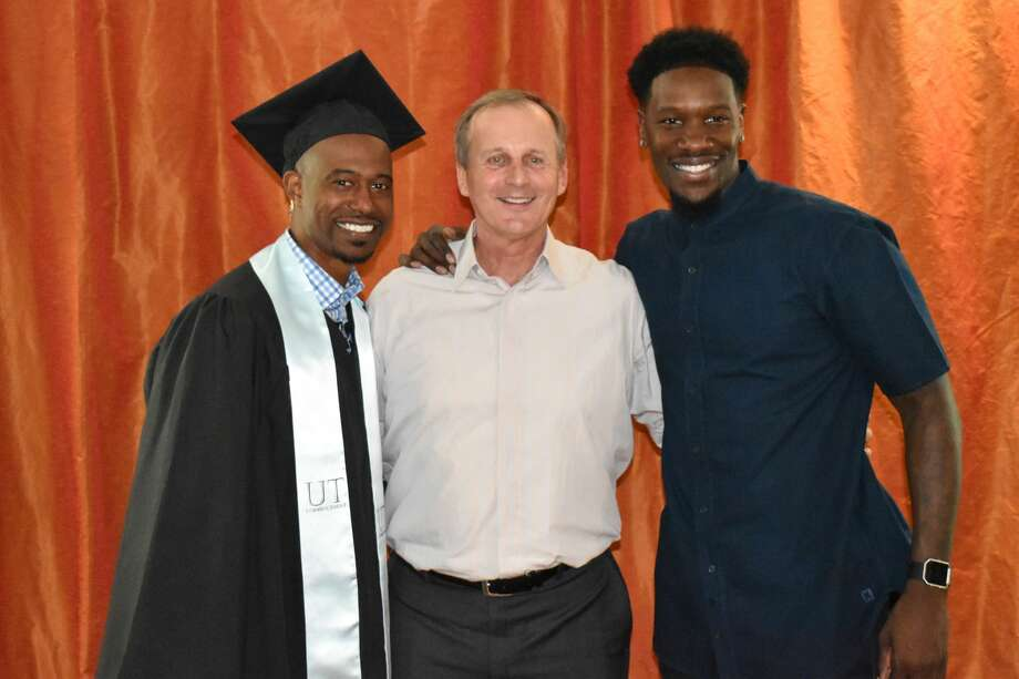 T.J. Ford celebrates his graduation from the University of Texas with former Longhorns basketball coach Rick Barnes and former Longhorns teammate Royal Ivey on Friday, May 19, 2017. Photo: University Of Texas Athletics