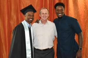 T.J. Ford celebrates his graduation from the University of Texas with former Longhorns basketball coach Rick Barnes and former Longhorns teammate Royal Ivey on Friday, May 19, 2017.
