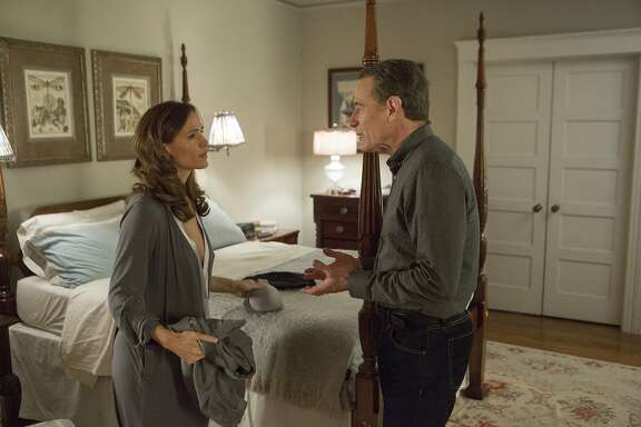 "This image released by IFC Films shows Jennifer Garner, left, and Bryan Cranston in a scene from, ""Wakefield."" (Gilles Mingasson/IFC Films via AP)"