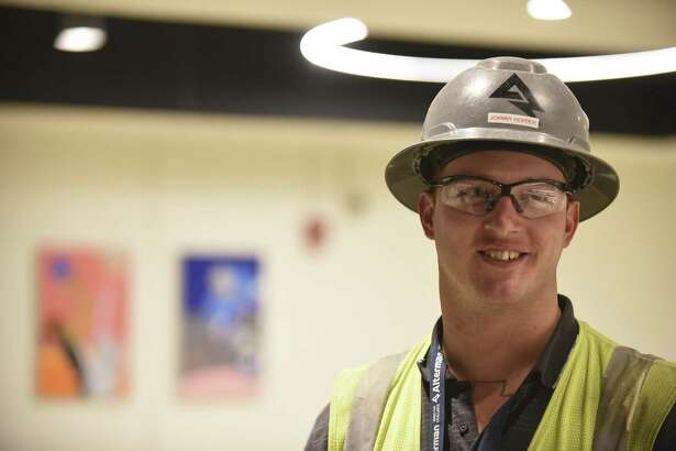"""Electrician John Hopper, who has a criminal past, got his job at the county-sponsored """"Second Chance Job Fair"""" at the AT&T Center in 2015. Another such job fair will happen Thursday."""