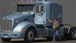 If you bought it, a truck brought it. It's this simple concept that means a border adjustment tax will mean higher costs for consumers. Here, truck driver Jesse Parks prepares to board a Peterbilt tractor rig in 2014 at Reynold's Nationwide trucking near China Grove.