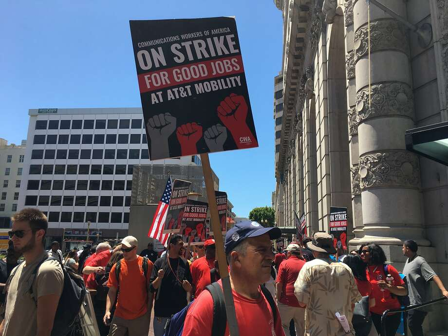 Workers strike outside of an AT& retail store in San Francisco on Friday. Photo: Dominic Fracassa