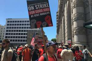Workers strike outside of an AT& retail store in San Francisco on Friday.