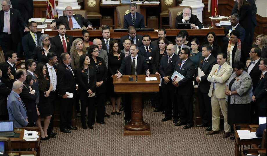 "Detractors of SB 4, whether through misunderstanding or a desire to be fearmongers, are misrepresenting what the legislation does. Here, Texas Rep. Rafael Anchia, D-Dallas, at podium, is surrounded by fellow lawmakers as he speaks against an anti-""sanctuary cities"" bill. Many Texas law enforcement officals opposed the law as well. Photo: Eric Gay /Associated Press / Copyright 2017 The Associated Press. All rights reserved."