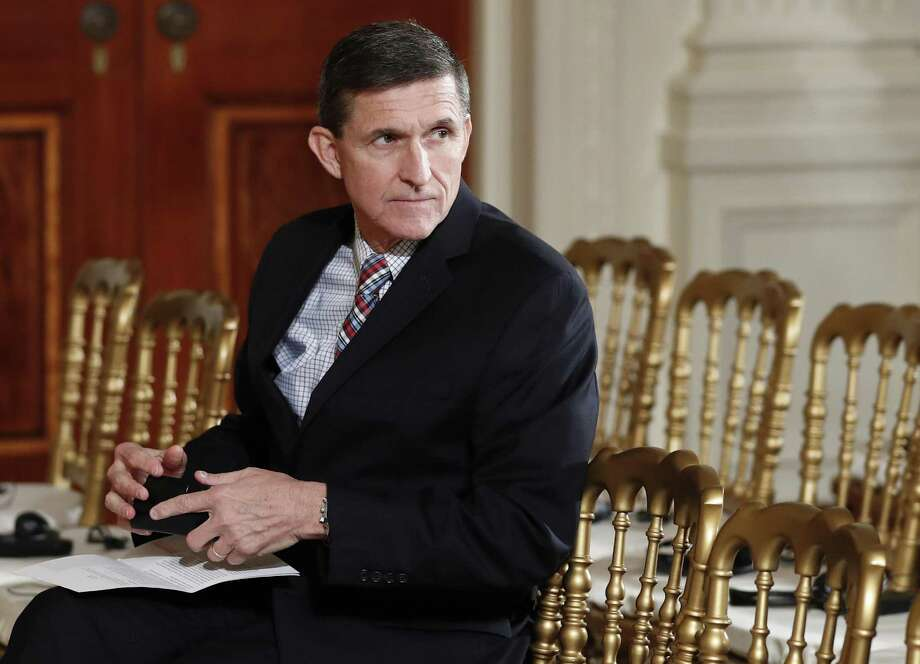 On Feb. 10, then-National Security Adviser Michael Flynn sits in the East Room of the White House in Washington. A report that President Trump, before he fired him, asked FBI Director James Comey to halt the investigation of whether Flynn had improper foreign ties, has just added to a general meltdown of the presidency. Photo: Carolyn Kaster /Associated Press / Copyright 2017 The Associated Press. All rights reserved.