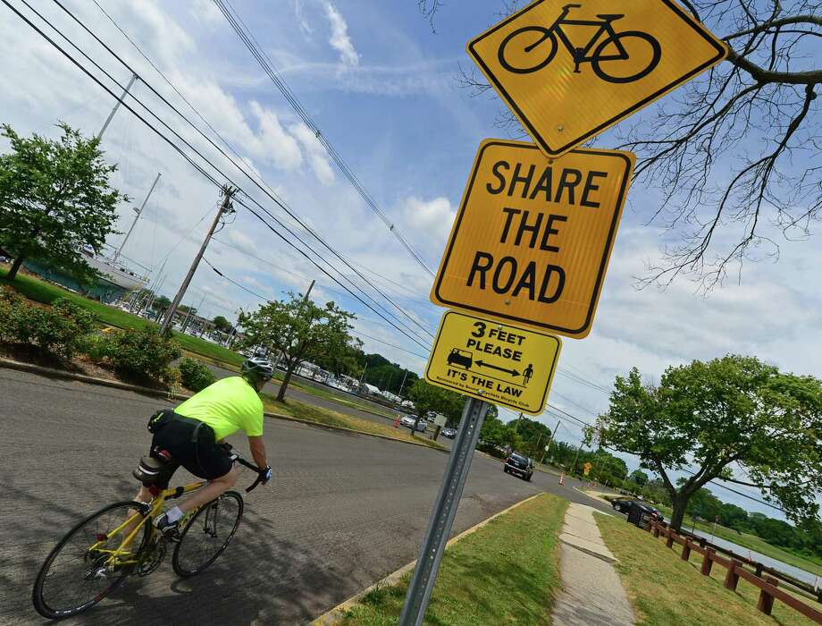 A bicyclist pedals down Calf Pasture Beach Road in July 2016. Photo: Erik Trautmann / Hearst Connecticut Media / (C)2016, Norwalk Hour, all rights reserved