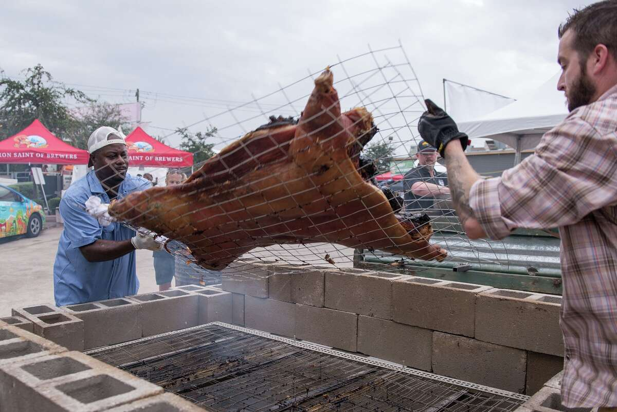 Rodney Scott and Patrick Feges flip a whole hog at Southern Smoke 2016.
