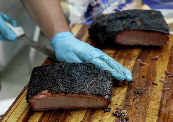 Aaron Franklin of Franklin Barbecue in Austin serves up brisket at his booth during Southern Smoke, a fundraiser for the National MS Society, Sunday, Nov. 6, 2016, in Houston. ( Melissa Phillip / Houston Chronicle )
