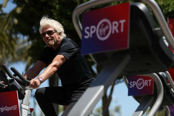 SAN FRANCISCO, CA - MAY 18: Sir Richard Branson rides an exercise bike during a news conference to announce the launch of Virgin Sport on May 18, 2017 in San Francisco, California. Virgin Group founder Sir Richard Branson announced Virgin Sport San Francisco, a half marathon run and fitness festival that is scheduled for October 14. (Photo by Justin Sullivan/Getty Images)