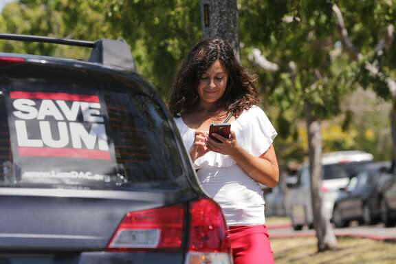 Ximena Stobaugh waits for her 2nd grade daughter to finish school for the day at  Donald D. Lum Elementary school in Alameda, Ca., as seen on Friday May 19, 2017. The school board will vote on wether to close the school citing the possibility of liquefaction during an earthquake.