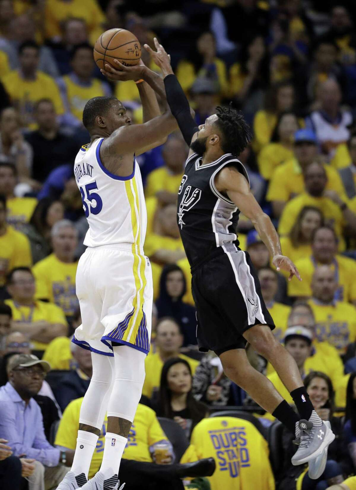 Golden State Warriors' Kevin Durant shoots over the Spurs' Patty Mills during the second half of Game 2 of the Western Conference finals on May 16, 2017, in Oakland, Calif.