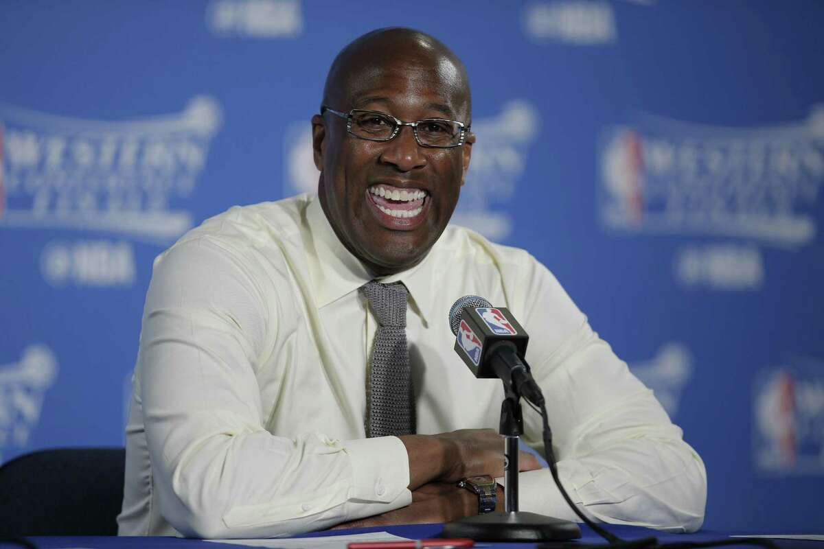 Golden State Warriors coach Mike Brown is all smiles during a news conference following the Game 2 rout of the Spurs in the Western Conference finals on May 16, 2017, at Oracle Arena in Oakland, Calif.