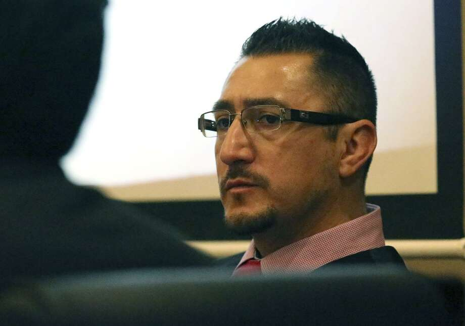 Richard Luis Amezquita sits Thursday May 18, 2017 in the 186th State District Court during his murder trial. Amezquita, a door-to-door salesman, shot and killed a man he said attacked him after Amezquita tried to sell him a home security system. Amezquita was arrested and charged with murder November 7, 2015 in the fatal shooting of Kerry O'Toole,53. Photo: John Davenport, STAFF / San Antonio Express-News / ©San Antonio Express-News/John Davenport