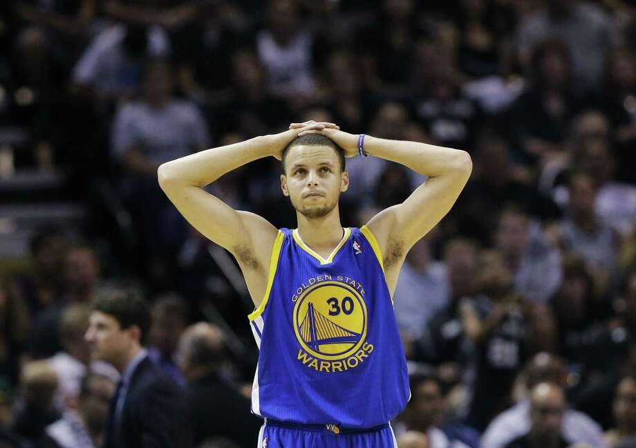 Golden State Warriors' Stephen Curry pauses during time out against the San Antonio Spurs during the first half in Game 5 of a Western Conference semifinal NBA basketball playoff series, Tuesday, May 14, 2013, in San Antonio. (AP Photo/Eric Gay) Photo: Eric Gay / AP / AP