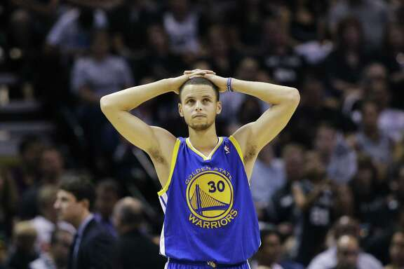 Golden State Warriors' Stephen Curry pauses during time out against the San Antonio Spurs during the first half in Game 5 of a Western Conference semifinal NBA basketball playoff series, Tuesday, May 14, 2013, in San Antonio. (AP Photo/Eric Gay)