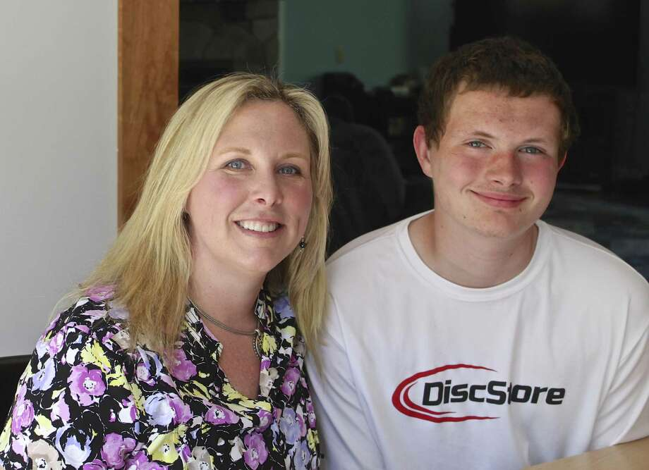 Laura Heneghan, a parent leader of the Danbury-area chapter of Smart Kids with Learning Disabilities, and her son, Brogan Heneghan, both of New Fairfield. Thursday, May 18, 2017. Photo: Anna Quinn / Hearst Connecticut Media / The News-Times