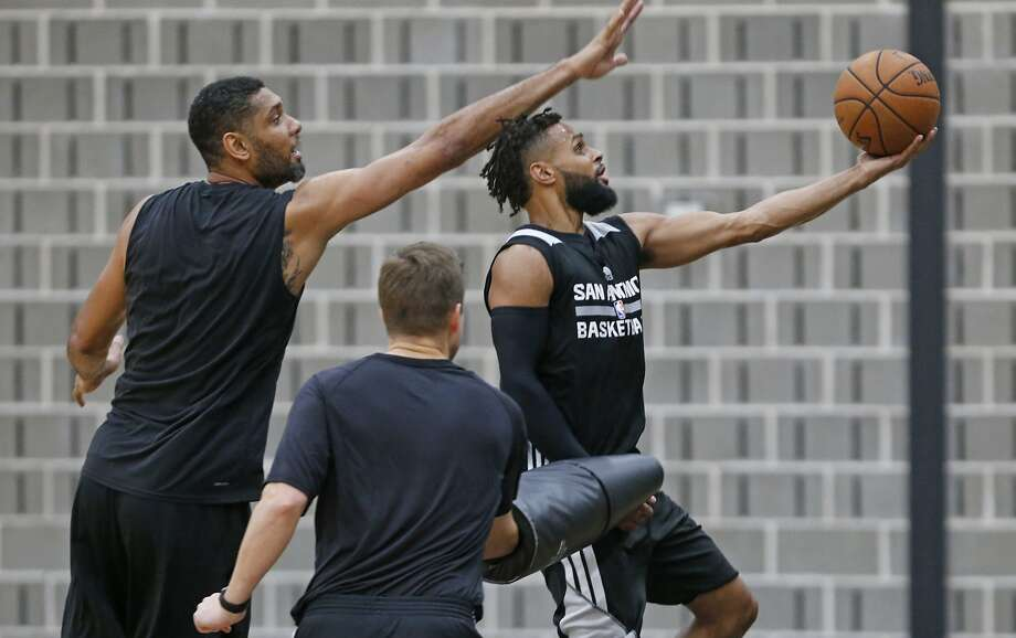 Patty Mills #8 of the San Antonio Spurs is guarded by Tim Duncan and in foreground Assistant coach Will Harding during practice. Spurs practice at Spurs Practice facility on  Thursday, 5.18,2017 Photo: Ron Cortes, Ronald Cortes