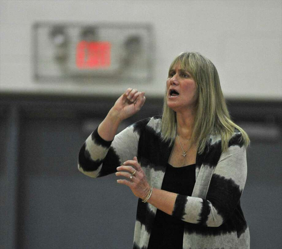Danbury head coach Jackie DiNardo shouts instructions to her players during the girls basketball game between Norwalk and Danbury high schools, on Thursday night, January 7, 2015, at Danbury High School, Danbury, Conn. Photo: H John Voorhees III / Hearst Connecticut Media / The News-Times