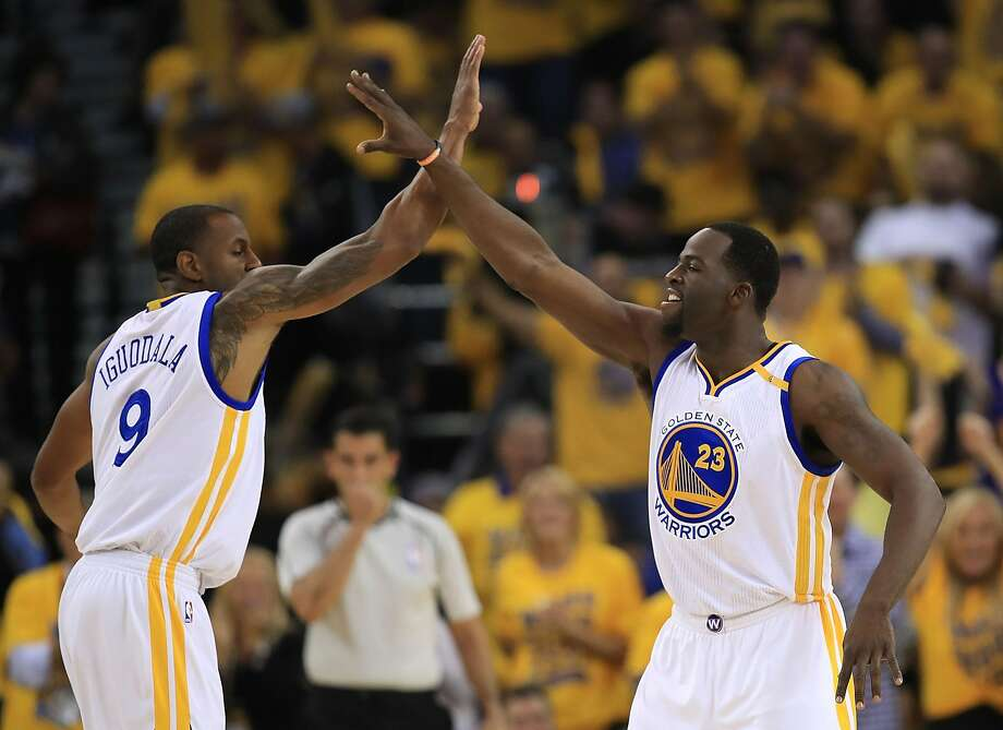 OAKLAND, CA - MAY 04:  Draymond Green #23 of the Golden State Warriors reacts with Andre Iguodala #9 after hitting a three-point basket against the Utah Jazz during Game Two of the NBA Western Conference Semi-Finals at ORACLE Arena on May 4, 2017 in Oakland, California.  NOTE TO USER: User expressly acknowledges and agrees that, by downloading and or using this photograph, User is consenting to the terms and conditions of the Getty Images License Agreement.  (Photo by Ezra Shaw/Getty Images) Photo: Ezra Shaw, Getty Images