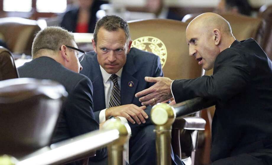 Representatives (from left) Tony Dale, R-Cedar Park, Jason Isaac, R-Dripping Springs and Matt Shaheen, R-Plano confer as property tax legislation is considered on the floor of the House at the Texas Capitol on May 18, 2017. Photo: Tom Reel, Staff / San Antonio Express-News / 2017 SAN ANTONIO EXPRESS-NEWS