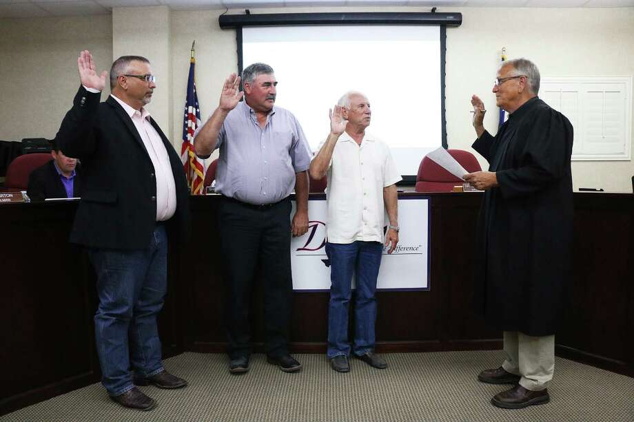 Mayor Jeff Lambright, Councilman Troy Barton, Pos. 5, and Councilman John S. Johnson, Pos. 4, receive the oath of office from Judge Alan D. Conner at the May 15 Dayton city council meeting. The trio of elected officials were unopposed in the last election campaign. Photo: David Taylor